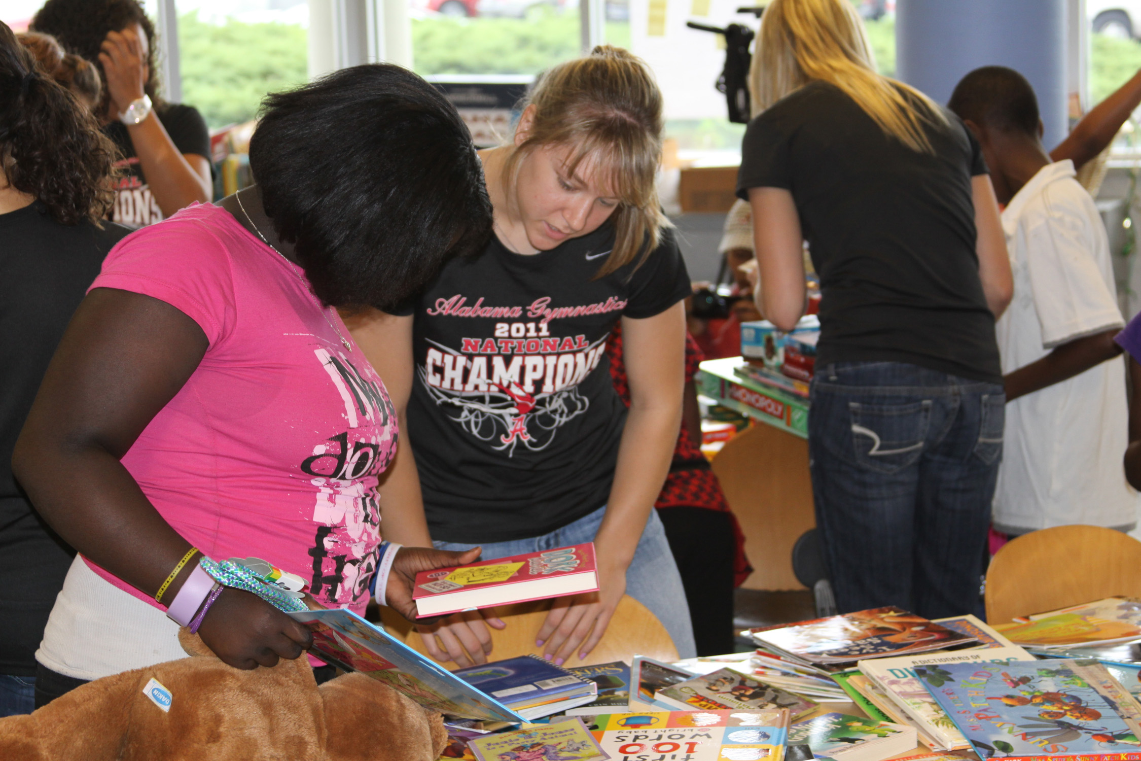 Bama Gymnasts Distribute Toys and Supplies at University Place Elementary