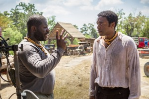 "Director Steve McQueen, left, and actor Chiwetel Ejiofor during the filming of ""12 Years A Slave."" (AP Photo/Fox Searchlight, Jaap Buitendijk)"